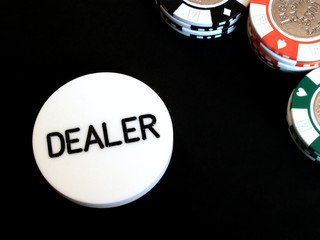 poker chips and dealer button