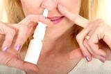 spraying nasal spray in nose poster