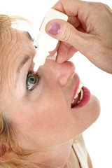 woman using eye drops 2