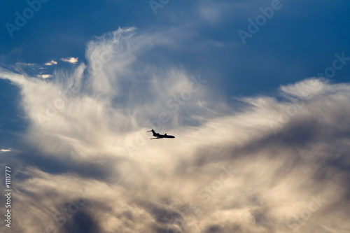 air-liner in evening cloudy sky