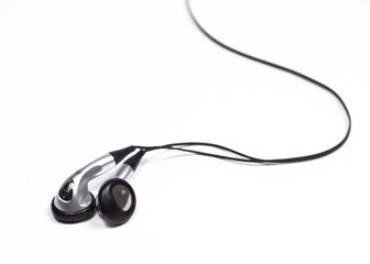 silver ear bud headphones