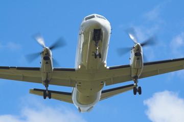 white plane landing at edinburgh airport, wings