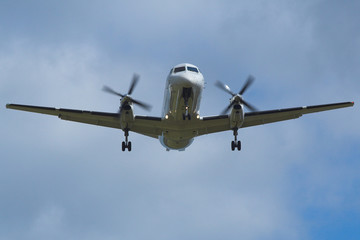 white plane aircraft landing at edinburgh airport