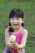 girl holding flower, smiling