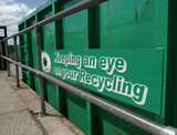green recycling container poster