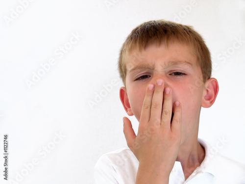boy yawning