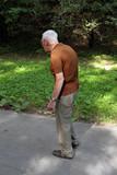 pensioner walking in park poster