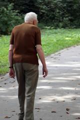 old man walking in park