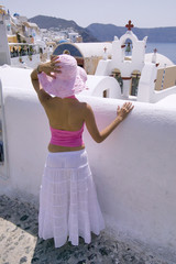 attractive young greek woman on the streets of oia