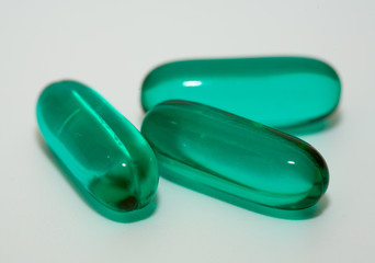 macro of green gel pills
