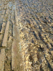 stone pavement half covered under water