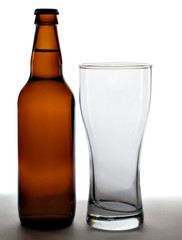 beer bottle and empty glass