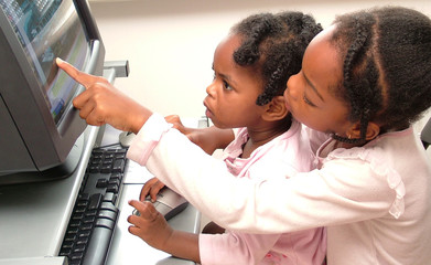 children having fun on home computer