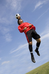 soccer football player making header