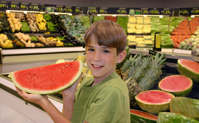 boy holding up watermelon