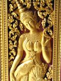 détail sculptures dorées entrée temple poster