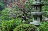 a stone lantern at a japanese garden in kyoto, jap poster