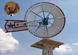 white windmill w/ yellow balloon poster