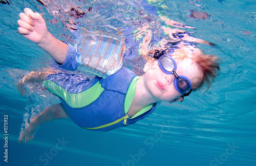 young boy swimming underwater and holding breath