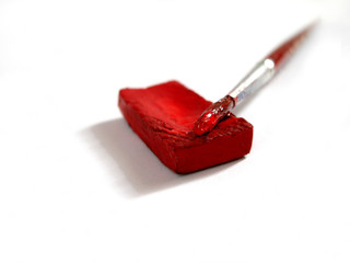 isolated red paint with brush