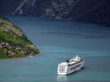 luxury cruise ship in a fjord poster