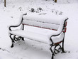 park bench covered with snow