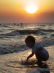 baby on sunset beach