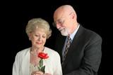 senior couple on black - romantic gesture poster