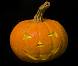 halloween pumpkin isolated on black background poster