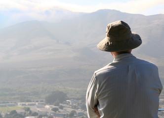 senior man looking out over a valley