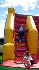 girls playing on a slide/game.girl falling down
