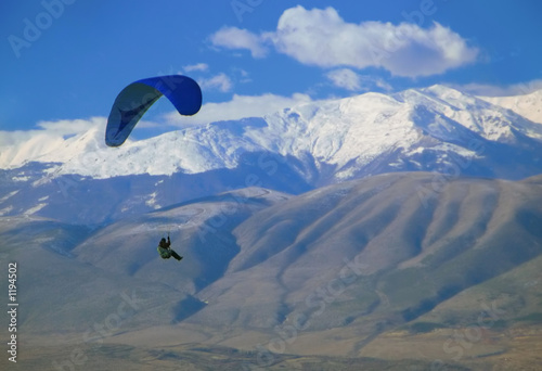 paraglider flying over macedonia