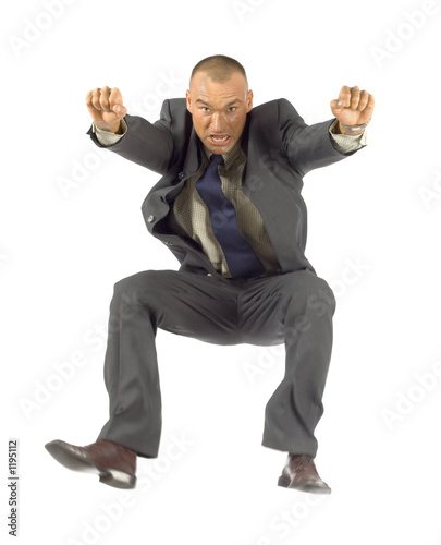 jumping  businessman looks angry/tired