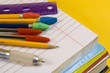 school supplies on yellow background - 1195911