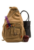 brown school back pack full of school supplies and an apple poster