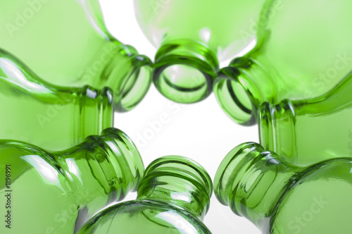 a group of green beer bottles - 1196991