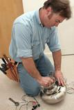 electrician assembles fan motor poster
