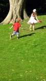 children/boy and girl running/playing poster