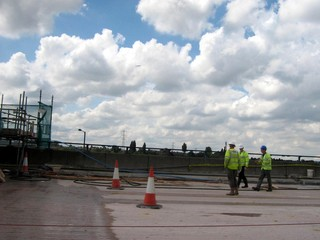 inspectors with roadworker on site
