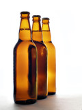 three beer bottles abreast poster