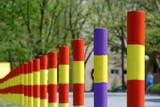 colored street poles in skopje, macedonia poster