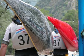 kayakers carrying kayak