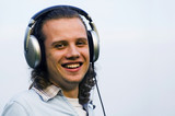 portrait of a smiling man with earphones poster