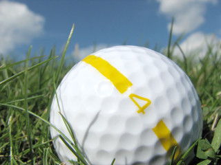 closeup of golf ball in grass
