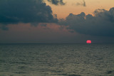 orange sun rising over atlantic ocean poster