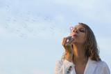 girl blowing soap bubbles poster