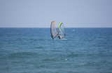 windsurfer on a beach of mediterranean sea