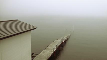 old pier in deep mist