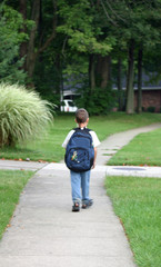 boy walking to bus stop