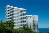two apartment-buildings by the sea poster